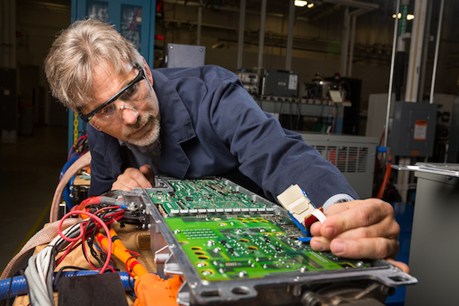employee with circuit board
