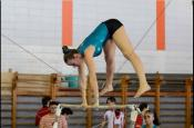 young adult female gymnast performing her gymnastics routine.