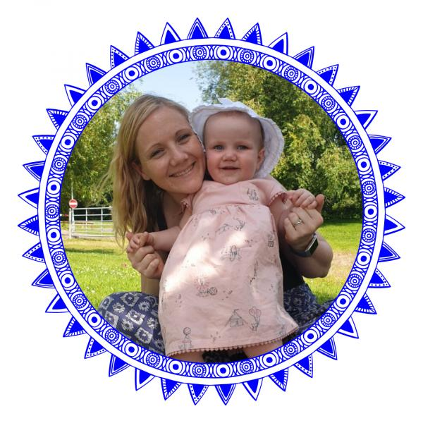 Woman and baby smiling in blue frame