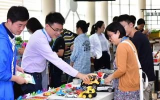 people shopping for gift items at a company's charity bazaar in shanghai.