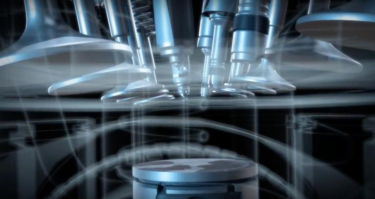 internal close up of an engine with the pistons in motion