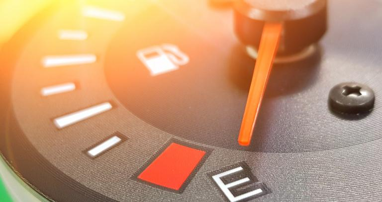 Close up of vehicle fuel gauge pointing to empty