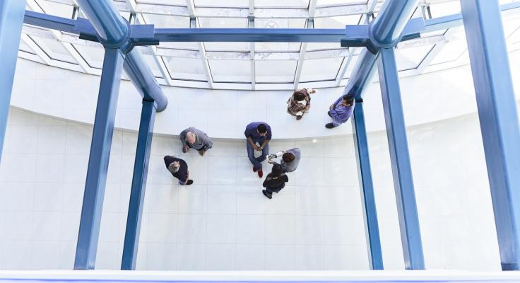 Aerial view of people in conversation in office building