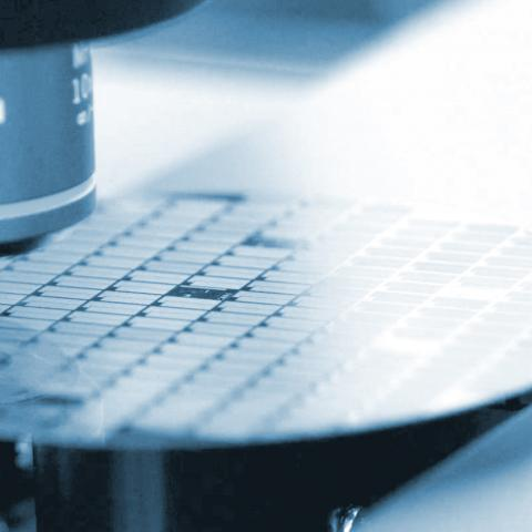 Close up of a high-tech computer chip being manufactured.
