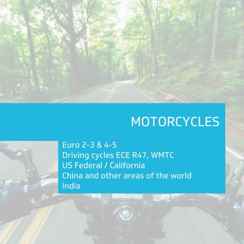 Section header with sub section listed in light blue box against open road with motorcycle handle bars.