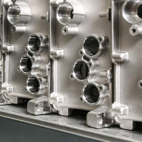 a close up of automotive components at a manufacturing plant.