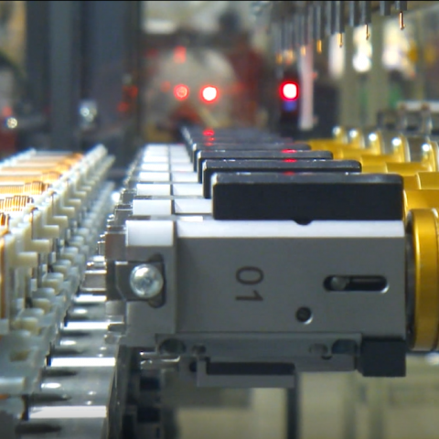 modular ignition coils moving down an assembly line